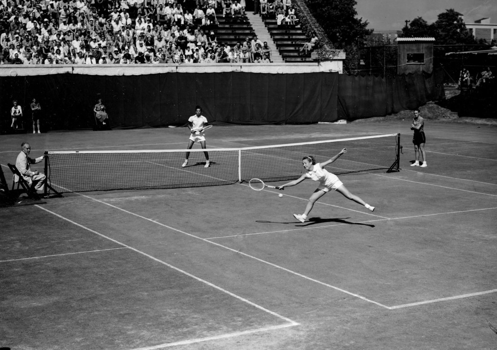 ". Maureen ""Little Mo\"" Connolly fails to return the ball to Althea Gibson in the National Tennis championships at Forest Hills in Queens, N.Y., on Sept. 5, 1953.  Connolly, the defending champion from San Diego, Ca., gained the semi-finals with a 6-2, 6-3 victory over Gibson of New York.  (AP Photo)"
