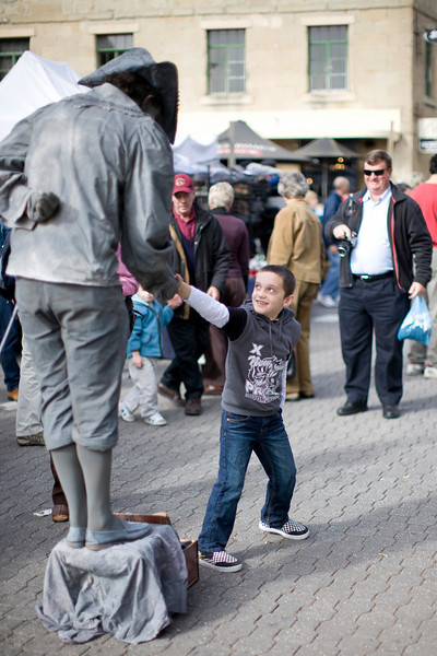 "This boy has been captured by a ""statue"" of Abel Tasman, the Dutch explorer who first discovered Tasmania."