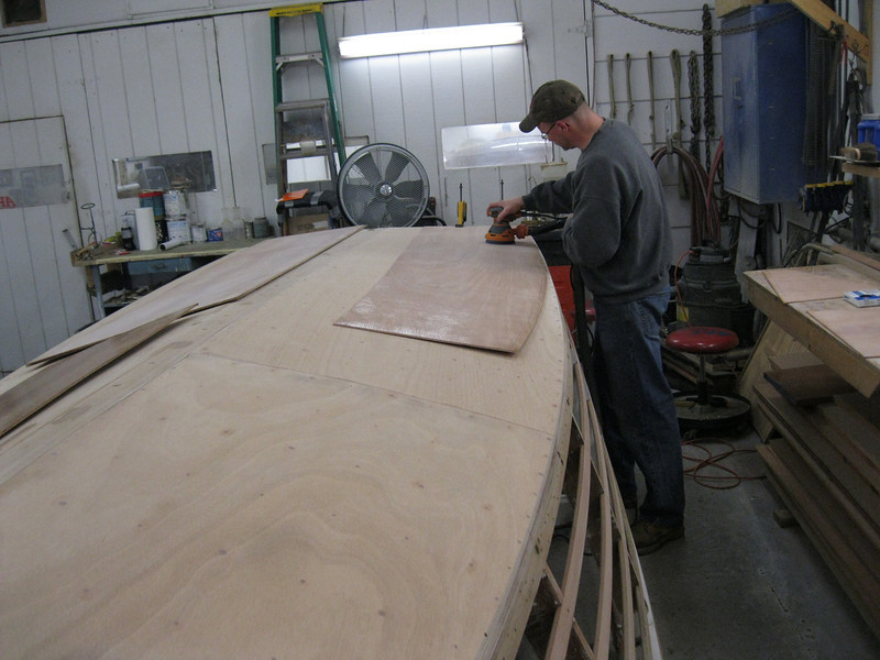 Sanding epoxy on the inside of the side plywood.
