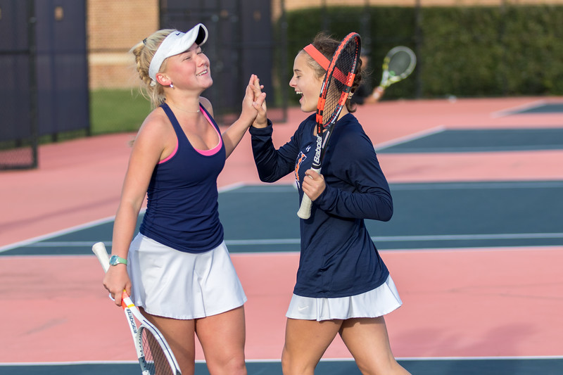 Caitie Sullivan and Jane Carter Chandler celebrate a point in the #1 doubles match