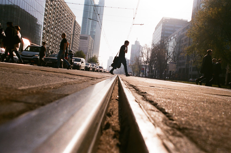 tram rail middle man walking autumn warsaw nikon fm2 analog fujifilm.jpg