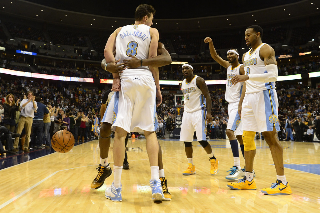 . DENVER, CO - FEBRUARY 5: Teammates celebrate a circus shot plus a free throw for Danilo Gallinari Denver Nuggets (8) after he was fouled by Mike Dunleavy Milwaukee Bucks (17) during the second half of action. The Denver Nuggets defeat the Milwaukee Bucks 112-104 in NBA action at the Pepsi Center. (Photo By AAron Ontiveroz/The Denver Post)