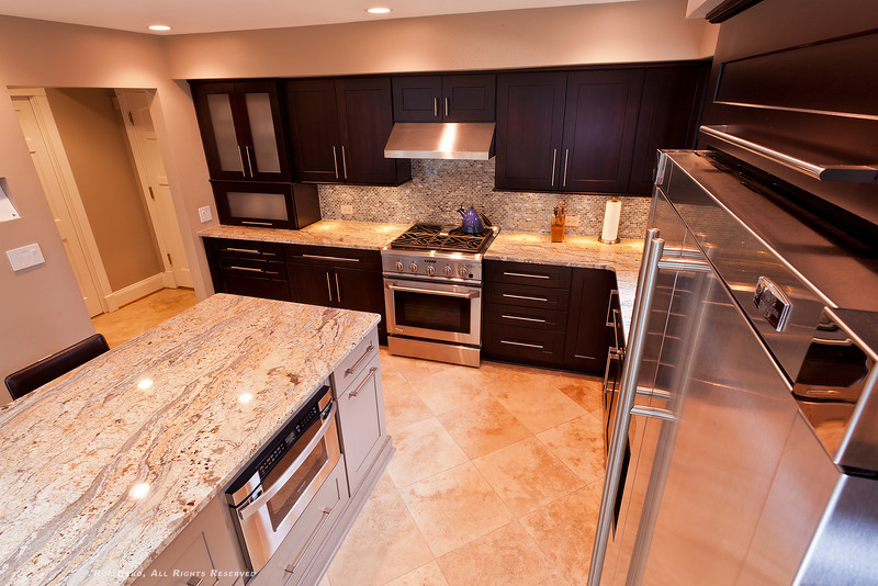 Newly renovated Kitchen, stainless steel appliances, massive island, dual fuel range, exterior-vented stainless hood, natural stone counter tops, tumbled glass tile back splash.