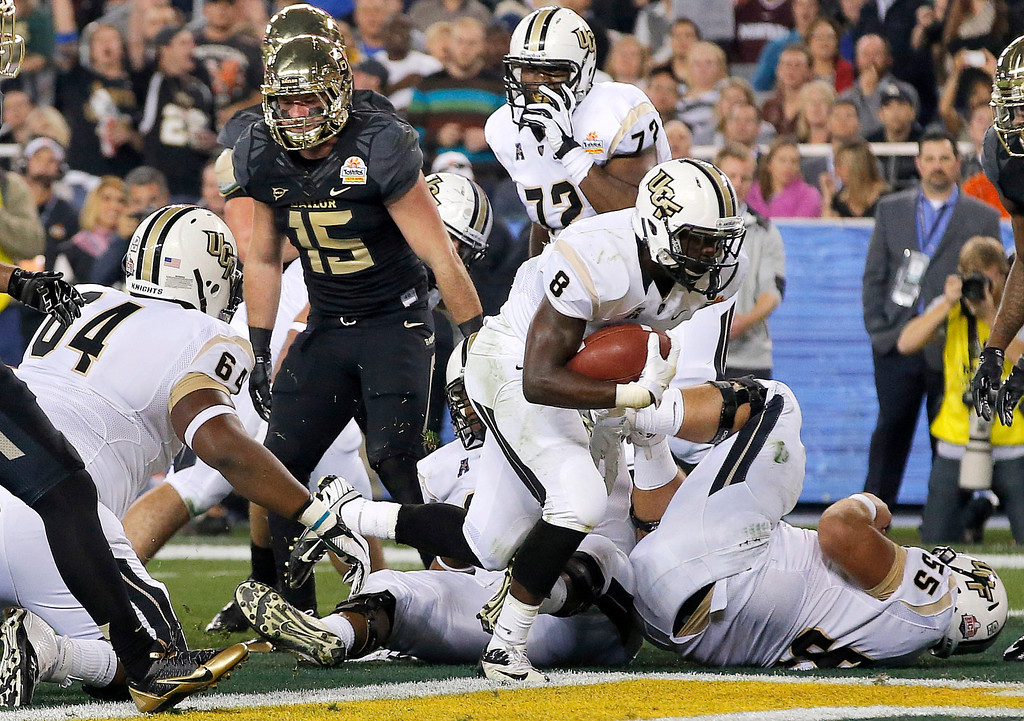 . Central Florida running back Storm Johnson (8) scores his second touchdown during the first half of the Fiesta Bowl NCAA college football game against Butler, Wednesday, Jan. 1, 2014, in Glendale, Ariz. (AP Photo/Ross D. Franklin)