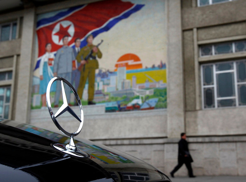 . A Mercedes-Benz car is seen parked outside the People\'s Cultural Palace where the World Congress on the Juche Idea is being held in Pyongyang, in this April 12, 2012 file photo. Chinese currency and U.S. dollars are being used more widely than ever in North Korea instead of the country\'s own money. The use of dollars and Chinese yuan, or renminbi, has accelerated since a revaluation of the North Korean won in 2009 wiped out the savings of millions of people, said experts on the country, defectors and Chinese border traders.   REUTERS/John Ruwitch