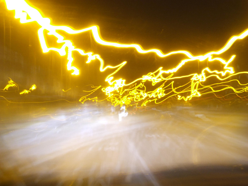 Light Trails, with camera placed on a car dashboard. Long exposure shot with the contours and bumps on the road.