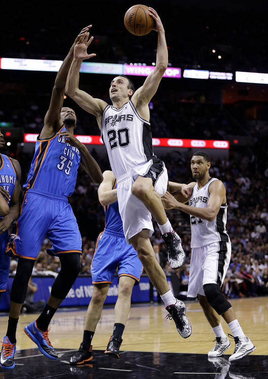 . San Antonio Spurs\' Manu Ginobili (20) shoots over Oklahoma City Thunder\'s Kevin Durant (35) during the first half of Game 5 of the Western Conference finals NBA basketball playoff series, Thursday, May 29, 2014, in San Antonio. (AP Photo/Eric Gay)