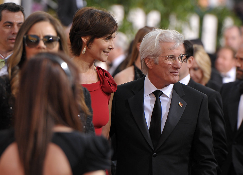Description of . Actors Carey Lowell, left, and Richard Gere arrive at the 70th Annual Golden Globe Awards at the Beverly Hilton Hotel on Sunday Jan. 13, 2013, in Beverly Hills, Calif. (Photo by John Shearer/Invision/AP)