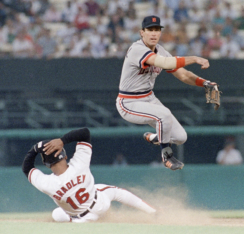 . ALAN TRAMMELL -- Detroit Tigers\' shortstop Alan Trammell turns the double play over the sliding Orioles Phil Bradley in the third inning of their game on July 1, 1989 at Memorial Stadium, Baltimore. (AP Photo/Jason Lee)