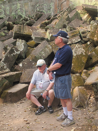 George Denham and Gerry Paul take a rest at Ta Prohm, Siem Reap province, Cambodia..