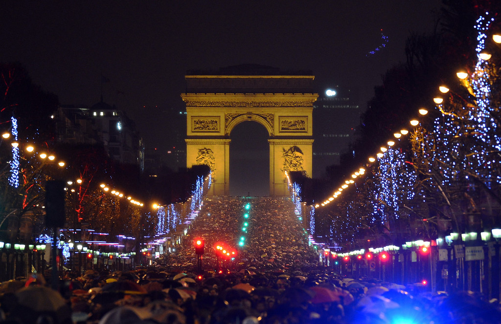 . People gather on the Champs-Elysees avenue in Paris to celebrate the New Year, late on December 31, 2012. MIGUEL MEDINA/AFP/Getty Images