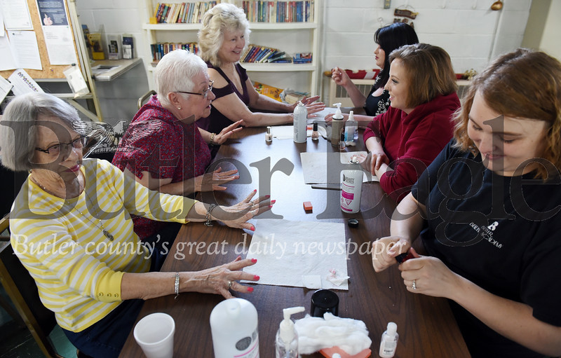 Harold Aughton/Butler Eagle: Students from the Butler Beauty School provided hand massages and painted nails at the Chicora Senior Center, Thursday, May 9.