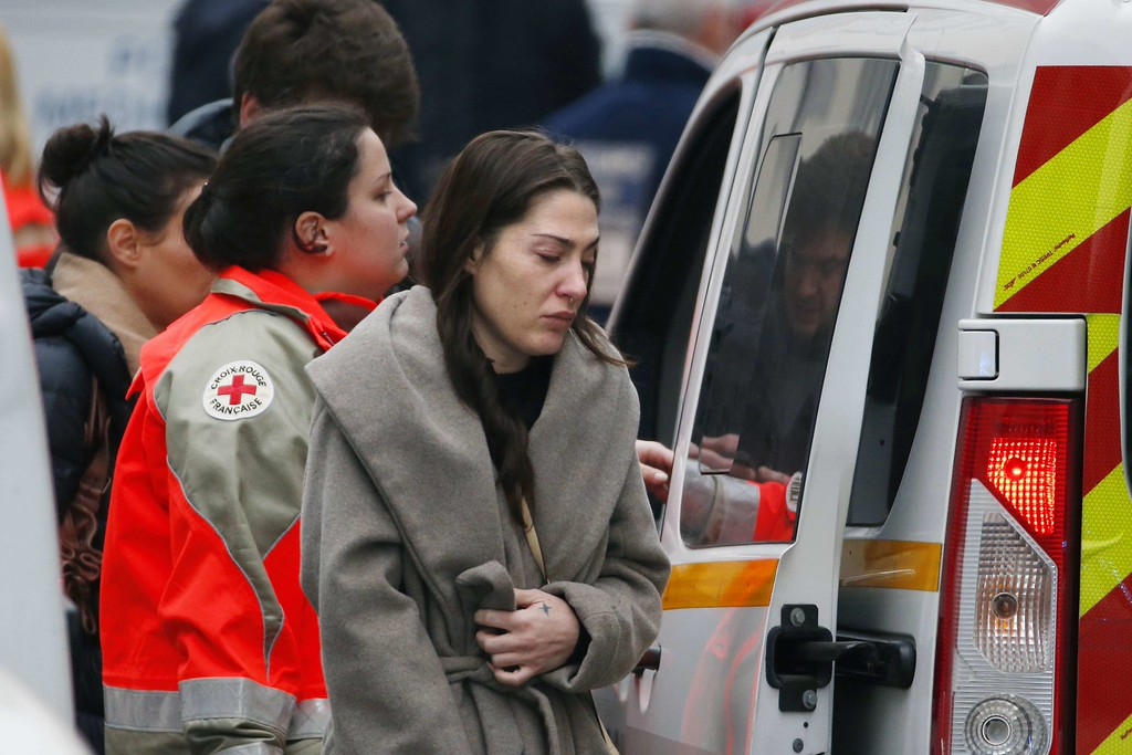 . A woman cries outside the headquarters of the French satirical newspaper Charlie Hebdo in Paris on January 7, 2015, after armed gunmen stormed the offices leaving twelve dead. Heavily armed gunmen shouting Islamist slogans stormed a Paris satirical newspaper office on January 7 and shot dead at least 12 people in the deadliest attack in France in four decades. Police launched a massive manhunt for the masked attackers who reportedly hijacked a car and sped off, running over a pedestrian and shooting at officers.     AFP PHOTO / KENZO  TRIBOUILLARD/AFP/Getty Images