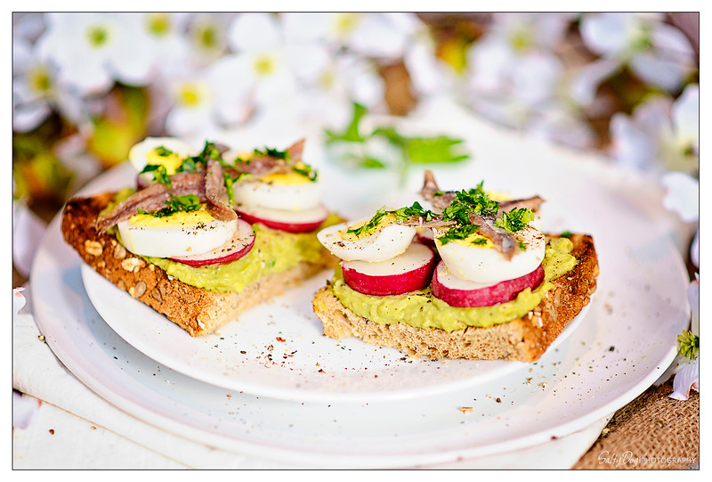 Avocado Toast with Hardboiled Egg, Radishes, and Anchovies