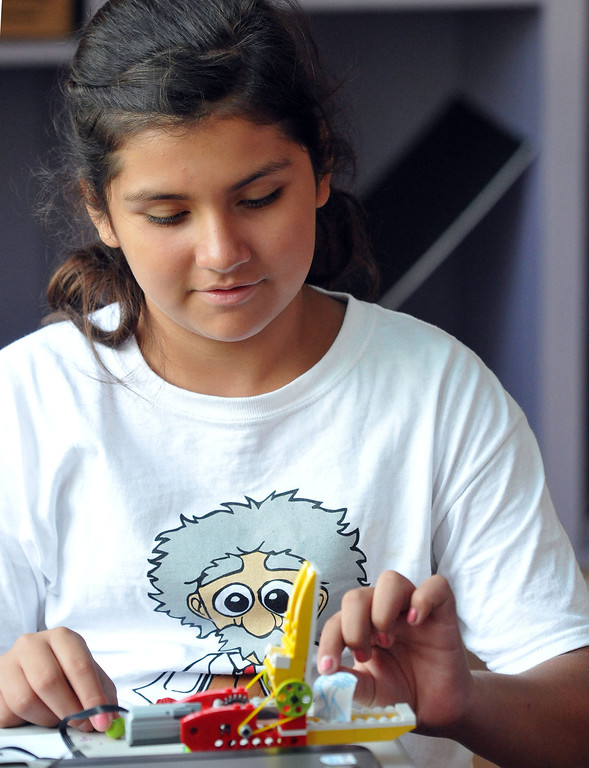 . (John Valenzuela/Staff Photographer) Angelica Abundis 11, puts a paper fish in the mouth of her robotic Lego alligator, during The Boys and Girls Club�s of Redlands\' Camp Einstein Camp, Thursday\'s at the Burrage Mansion in Redlands, Aug. 2, 2013. Camp Einstein campers used Lego Education WeDo Robotics and assembled a robotic Lego alligator features working motors and sensors, then add movement with a computer program to control the robotic animal.