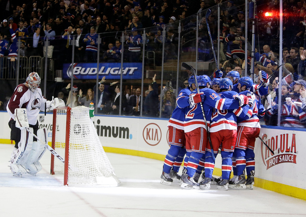 . Colorado Avalanche goalie Semyon Varlamov (1), of Russia, reacts as the New York Rangers celebrate a goal by Kevin Hayes during the second period of an NHL hockey game Thursday, Nov. 13, 2014. (AP Photo/Frank Franklin II)