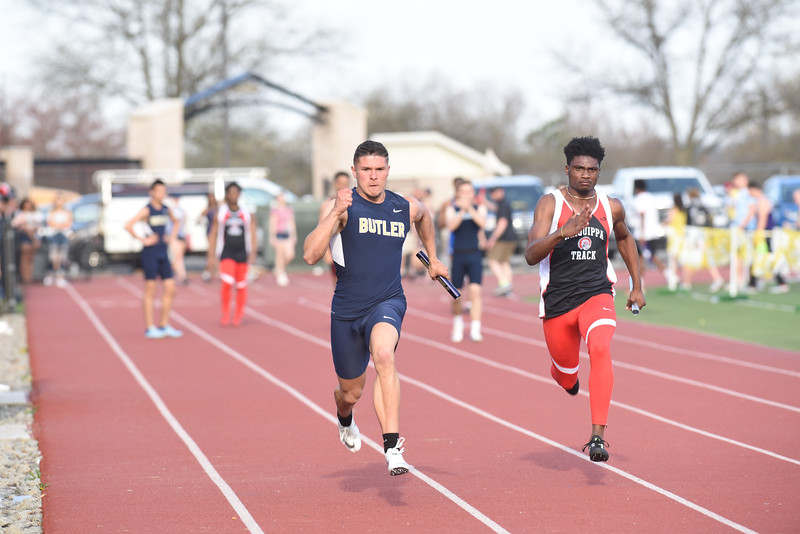 Butler's Ryan Marcella pushes to the finish in the 4x100 Thursday at the Butler Invitational. Seb Foltz/Butler Eagle.