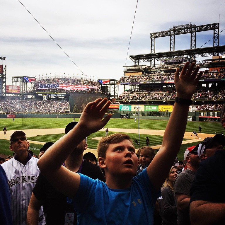 . Reaching to the heavens for free cracker jacks during the seventh inning stretch. #rockies #openingday � @shootsethshoot  Denver post photographer Seth McConnell covered the Colorado Rockies opening day, on April 8, 2016, using the photo app Hipstamatic and publishing on Instagram.