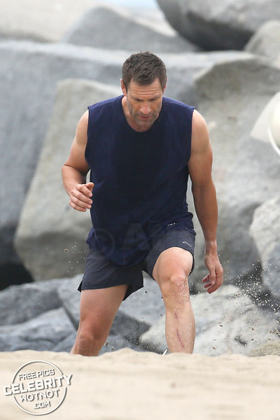 EXC: Aaron Eckhart Shows Off Ripped Body During Intense Workout