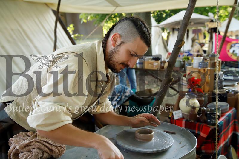 Slippery Rock graduate Joshua Hassan of Ellwood City works on a potter's wheel project at Zelienople Fall Festival Saturday. Seb Foltz/Butler Eagle 2019