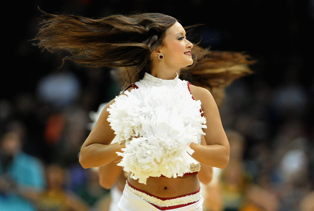 . Oklahoma Sooners cheerleaders perform during halftime of the game between the Oklahoma Sooners and the North Dakota State Bison during the second round of the 2014 NCAA Men\'s Basketball Tournament at Spokane Veterans Memorial Arena on March 20, 2014 in Spokane, Washington.  (Photo by Steve Dykes/Getty Images)