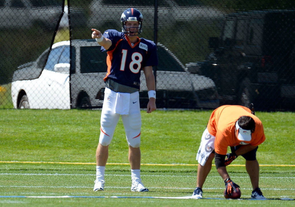 . Denver Broncos QB Peyton Manning (18) runs through drills during training camp August 5, 2013 at Dove Valley. (Photo By John Leyba/The Denver Post)