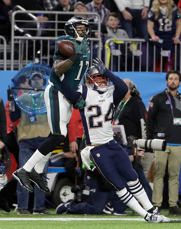 . New England Patriots\' Stephon Gilmore (24) breaks up a pass intended for Philadelphia Eagles\' Alshon Jeffery during the first half of the NFL Super Bowl 52 football game Sunday, Feb. 4, 2018, in Minneapolis. The Patriots intercepted the pass. (AP Photo/Matt Slocum)