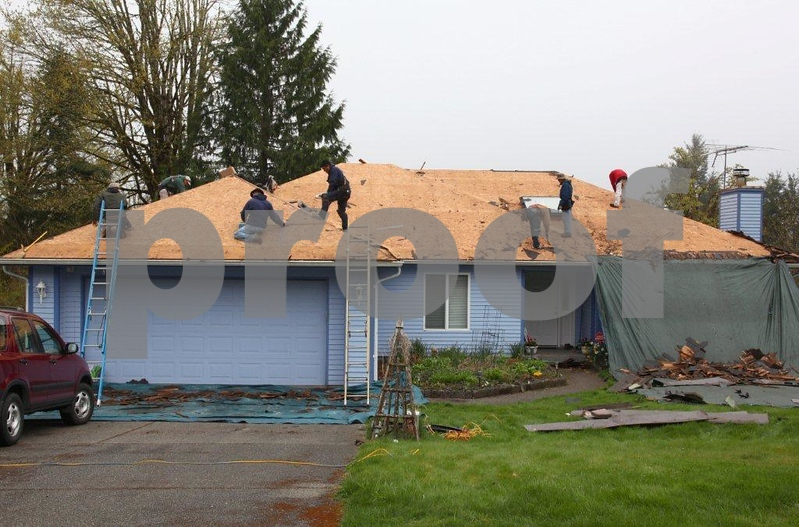 The second in a time series showing the removal of the 19-year old cedar shake roof.