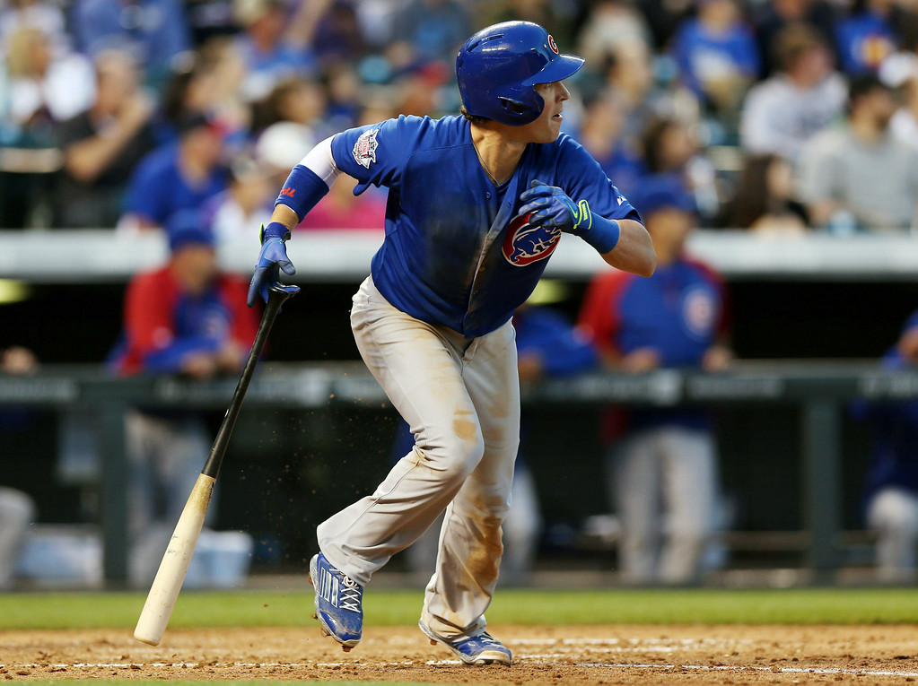 . Chicago Cubs\' Chris Coghlan follows the flight of his RBI-double against the Colorado Rockies in the fifth inning of a baseball game in Denver on Wednesday, Aug. 6, 2014. (AP Photo/David Zalubowski)