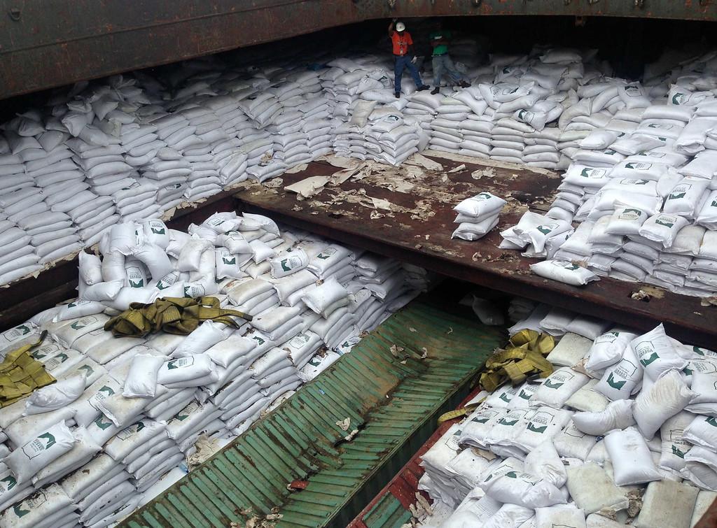 ". Bags labeled \""Cuban Raw Sugar\"" are seen inside a North Korean flagged ship \""Chong Chon Gang\"" docked at the Manzanillo Container Terminal in Colon City July 16, 2013. REUTERS/Carlos Jasso"
