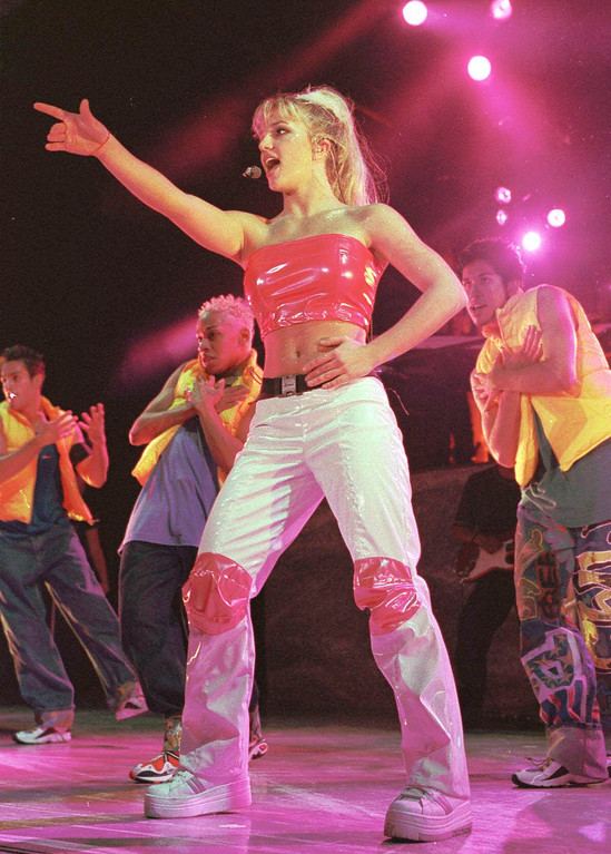 """. Britney Spears kicks off her \""""Baby One More Time\"""" tour at the Pompano Beach Amphitheater Monday, June 28, 1999, in Pompano Beach, Fla. Spears, from Kentwood, La., will tour through mid September. (AP Photo/Terry Renna)"""