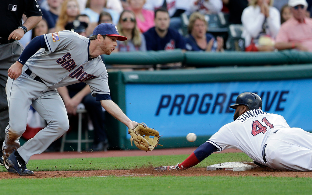 . San Diego Padres\' Cory Spangenberg waits for the ball as Cleveland Indians\' Carlos Santana safely steals third base in the third inning of a baseball game, Tuesday, July 4, 2017, in Cleveland. Santana stole third base on a throwing error by catcher Austin Hedges. (AP Photo/Tony Dejak)