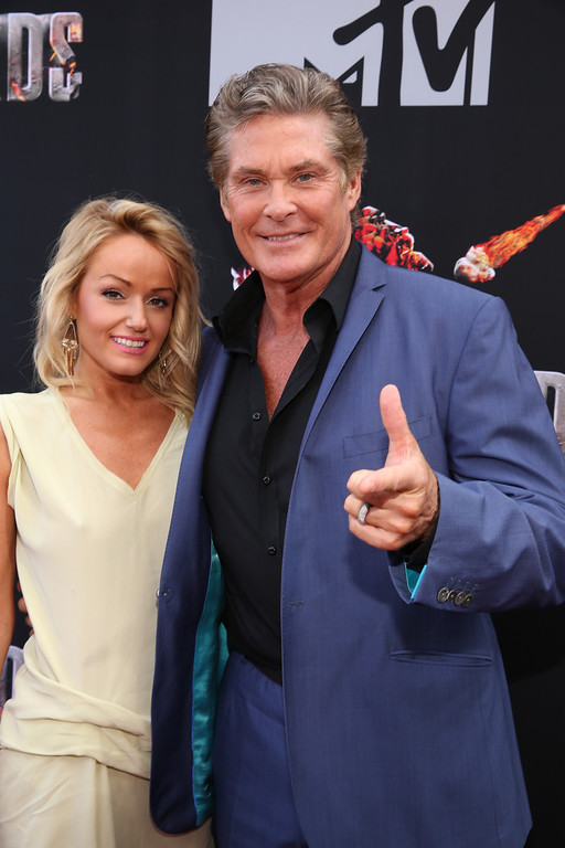 . Actor David Hasselhoff (R) and Hayley Roberts attend the 2014 MTV Movie Awards at Nokia Theatre L.A. Live on April 13, 2014 in Los Angeles, California.  (Photo by Rich Polk/Getty Images for MTV)