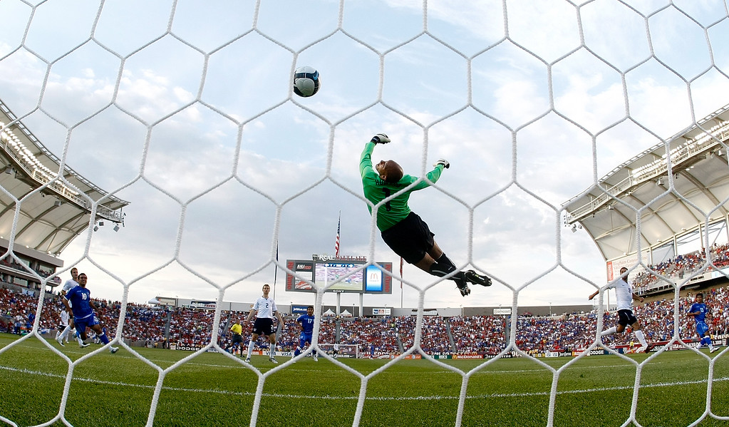 . Goalkeeper Tim Howard #1 of the United States stretches attempts to reach a goal strike by Christian Castillo #17 of ElSalvador in the first half during the FIFA 2010 World Cup Qualifier match between the United States and El Salvador at Rio Tinto Stadium on September 5, 2009 in Sandy, Utah.  (Photo by Jonathan Ferrey/Getty Images)