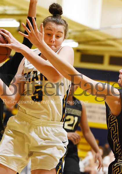 Harold Aughton/Butler Eagle: Mars Ava Black, #5, rips an offensive rebound during last night's game against Gateway, Monday, January, 20, 2020.
