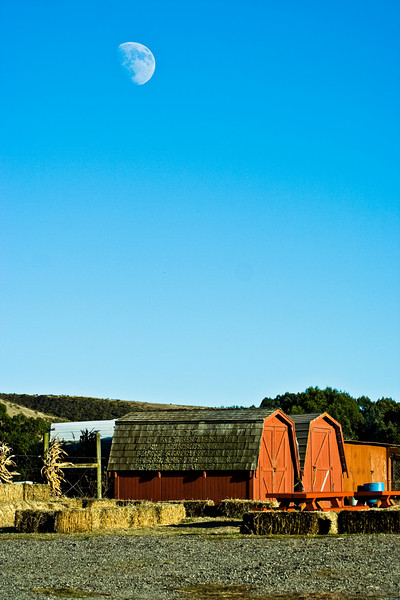 Moon over red barn