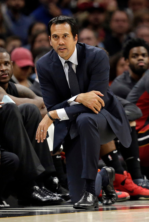 . Miami Heat head coach Erik Spoelstra watches in the second half of an NBA basketball game against the Cleveland Cavaliers, Tuesday, Nov. 28, 2017, in Cleveland. The Cavaliers won 108-97. (AP Photo/Tony Dejak)