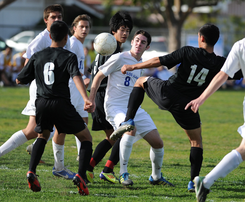 . 02-15-2012--(LANG Staff Photo by Sean Hiller)- Los Alamitos beat Buena 4-1 in the first round of the Division 1 boys soccer playoffs Friday at Laurel School in Los Alamitos. Sam Rudich (8) finds himself heavily guarded by Buena defense.