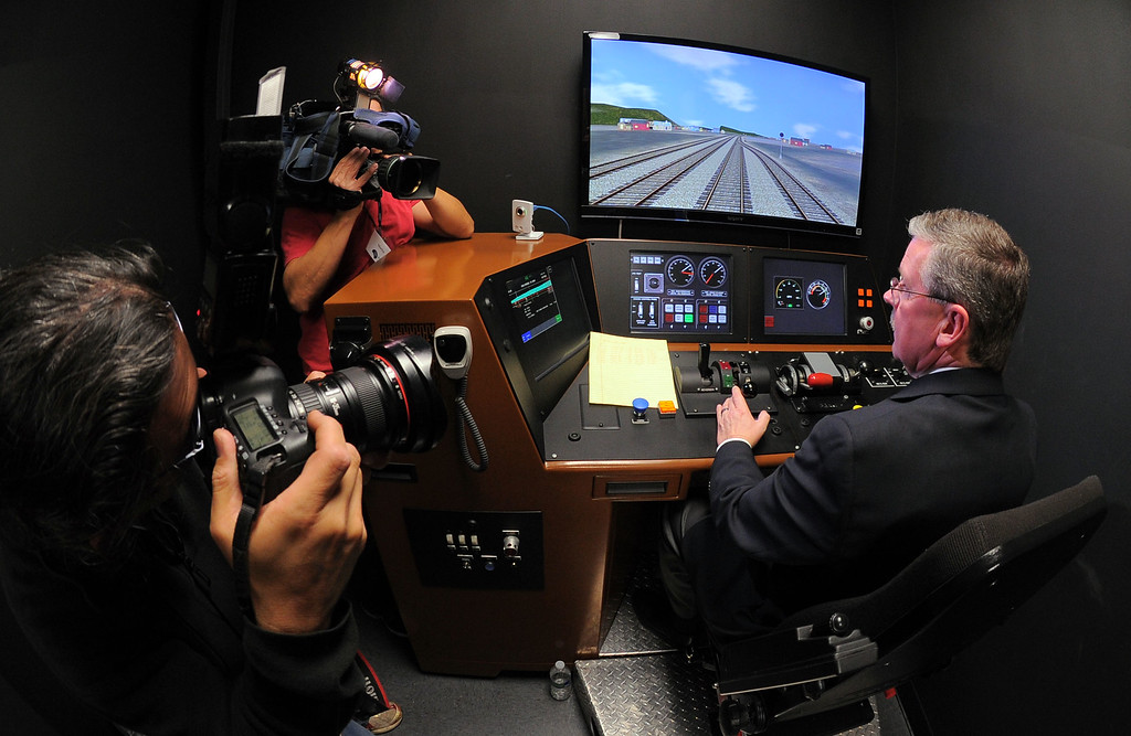 . Metrolink\'s R.T. McCarthy gives a demonstration in a training simulator of their new Positive Transfer Control (PTC) during an event in Los Angeles, CA on Thursday, February 20, 2014. The computer and satellite devices will be installed in all Metrolink trains and should prevent accidents. (Photo by Scott Varley, Daily Breeze)