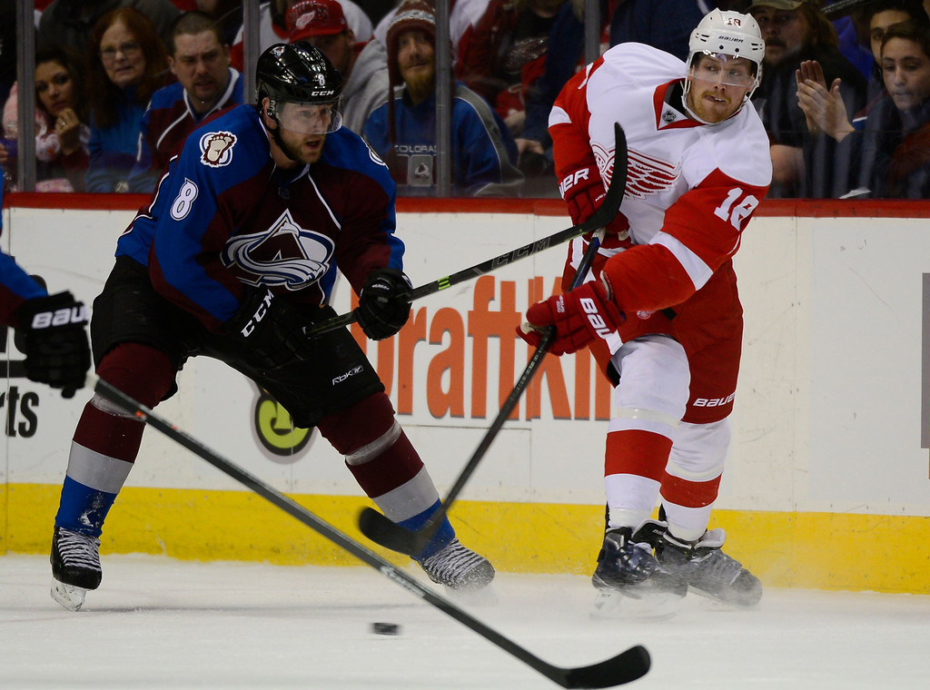 . DENVER, CO - February 5: Detroit Red Wings center Joakim Andersson (18) gets a pass to a team mate around the defense of Colorado Avalanche defenseman Jan Hejda (8) during the first period Thursday, February 5, 2015 at the Pepsi Center in Denver, Colorado. (Photo By Brent Lewis/The Denver Post)