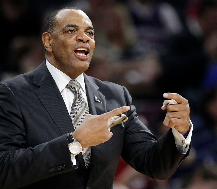 . Brooklyn Nets coach Lionel Hollins signals his team during the second half of an NBA basketball game against the Detroit Pistons on Saturday, Nov. 1, 2014, in Auburn Hills, Mich. The Nets defeated the Pistons 102-90. (AP Photo/Duane Burleson)