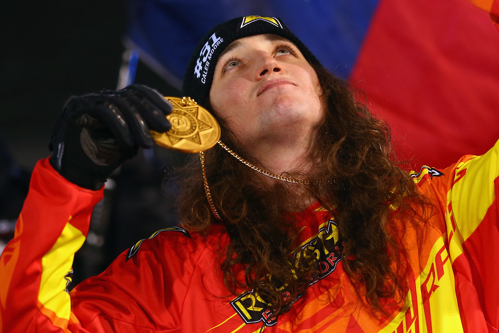 . Colten Moore gestures skyward as he celebrates with the gold medal after winning the snowmobile freestyle finals at Winter X-Games 2014 Aspen at Buttermilk Mountain on January 23, 2014 in Aspen, Colorado. Moore\'s brother Caleb Moore died as a result of injuries from a snowmobile accident at Winter X Games 2013.  (Photo by Doug Pensinger/Getty Images)