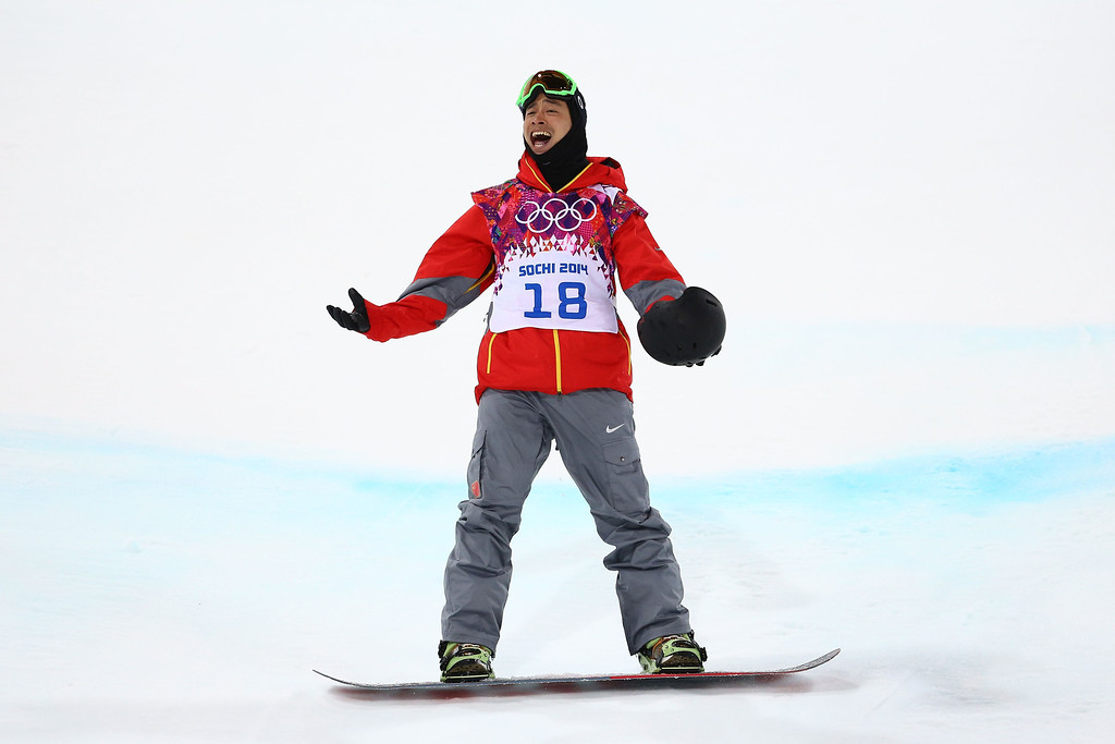 . Wancheng Shi of China reacts after competing in the Snowboard Men\'s Halfpipe Finals on day four of the Sochi 2014 Winter Olympics at Rosa Khutor Extreme Park on February 11, 2014 in Sochi, Russia.  (Photo by Al Bello/Getty Images)