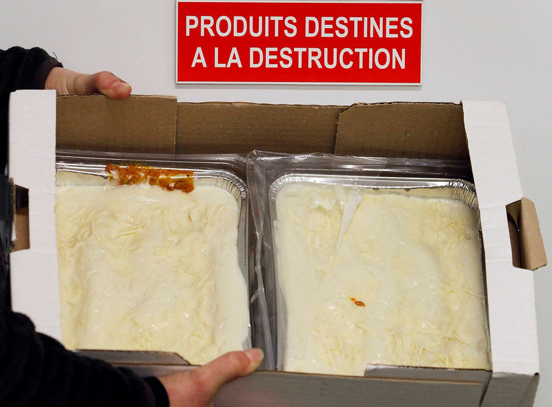 ". An employee displays a case of frozen beef lasagna dinners, removed from stores and prepared for destruction, under a sign on a door which reads ""Products for Destruction\"" in a central purchasing warehouse in Villeneuve, Southwestern France, February 15, 2013. An investigation has identified a French meat-processing firm as a likely culprit in the horsemeat scandal that has enraged consumers across Europe and implicated traders and abattoirs from Cyprus to Romania.      REUTERS/Regis Duvignau"