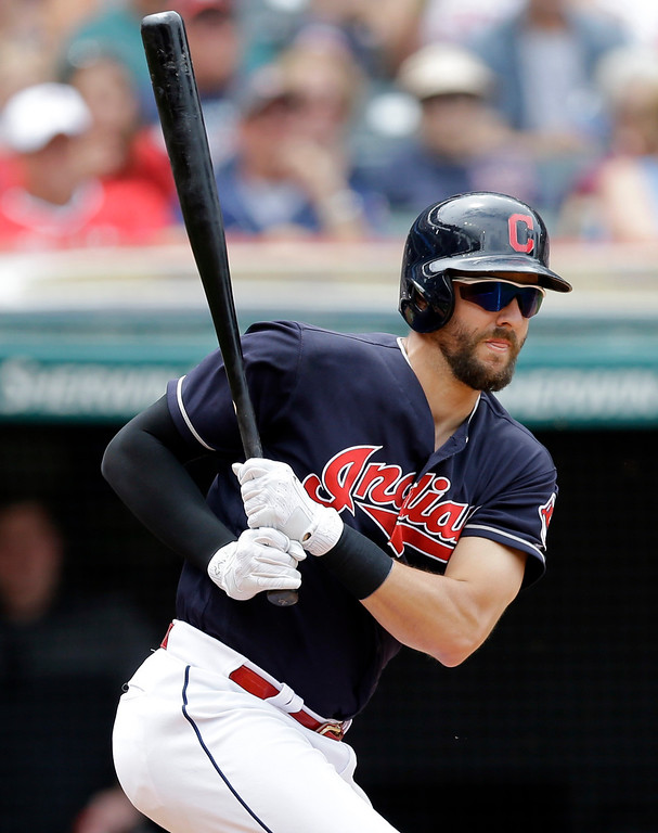 . Cleveland Indians\' Lonnie Chisenhall watches hits ball after hitting a two-run double off Texas Rangers relief pitcher Nick Martinez in the sixth inning of a baseball game, Thursday, June 29, 2017, in Cleveland. Edwin Encarnacion and Jose Ramirez scored on the play. (AP Photo/Tony Dejak)