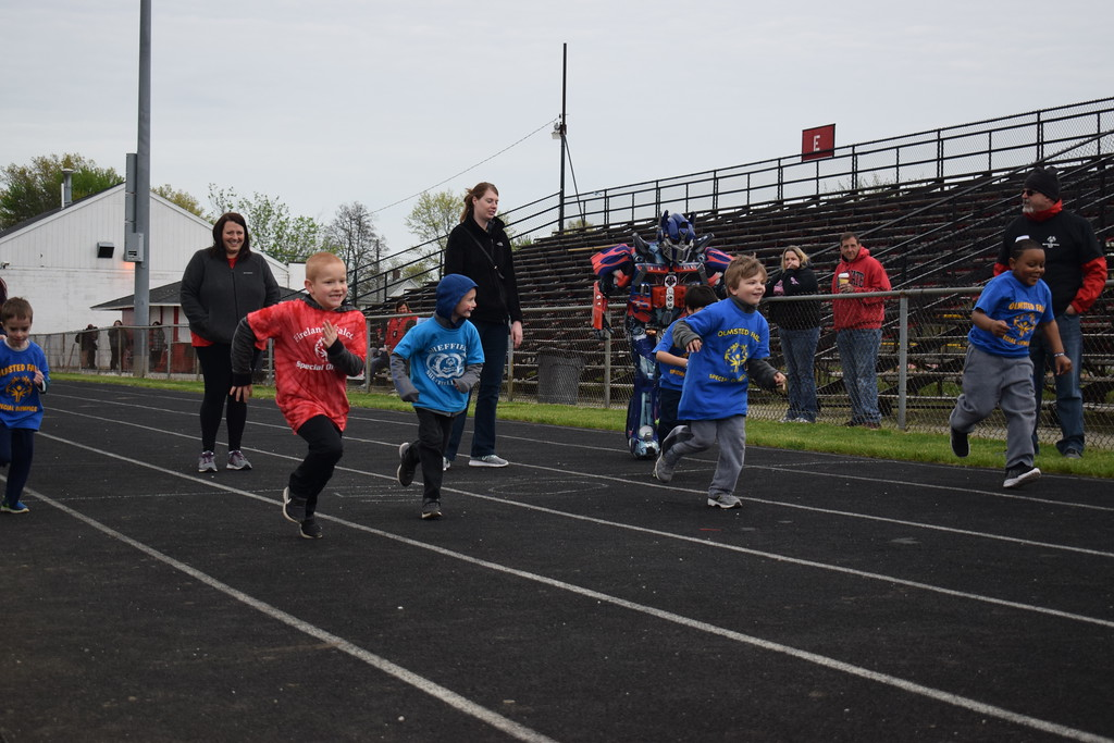 . Briana Contreras � The Morning Journal <br> Young athletes sprint to the finish in the Under 8 50 Meter Dash at the 38th Annual Lorain County Special Olympics Track and Field Event held on May 11 at Ely Stadium in Elyria.