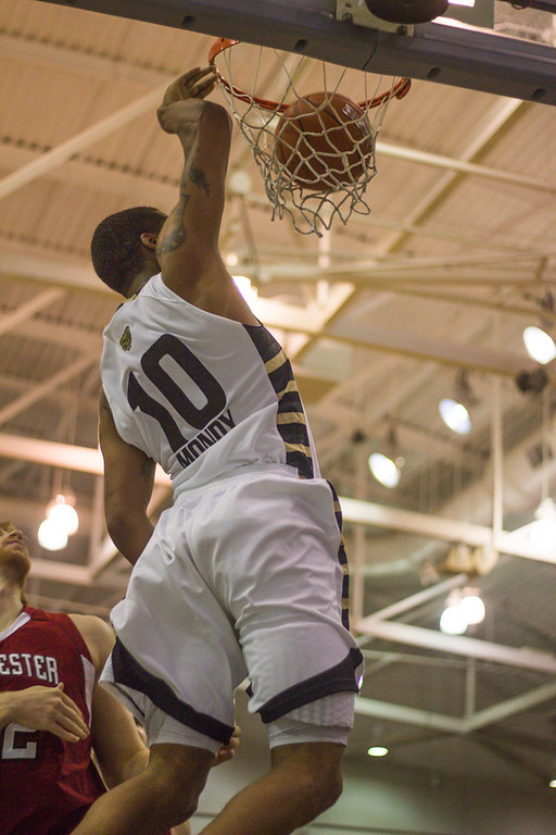 . After a full-court breakaway, Mondy slam-dunks the ball during the second half. Photo by Dylan Dulberg