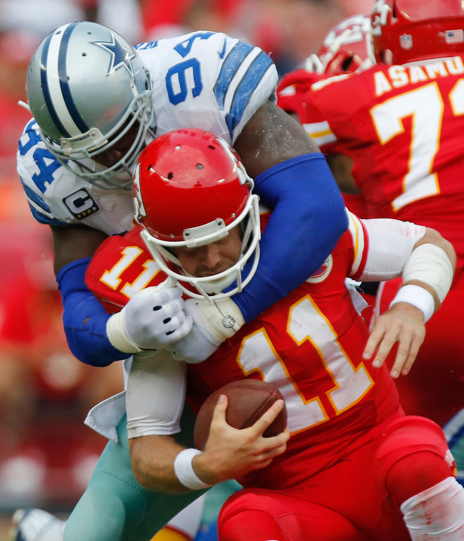 . Kansas City Chiefs quarterback Alex Smith (11) is sacked by Dallas Cowboys defensive end DeMarcus Ware (94) during the first half of an NFL football game at Arrowhead Stadium in Kansas City, Mo., Sunday, Sept. 15, 2013. (AP Photo/Ed Zurga)