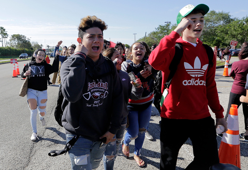. Students walk out of Marjory Stoneman Douglas High School, as part of a nationwide protest against gun violence, Wednesday, March 14, 2018, in Parkland, Fla. Organizers say nearly 3,000 walkouts are set in the biggest demonstration yet of the student activism that has emerged following the massacre of 17 people at Marjory Stoneman Douglas High School in February. (AP Photo/Lynne Sladky)