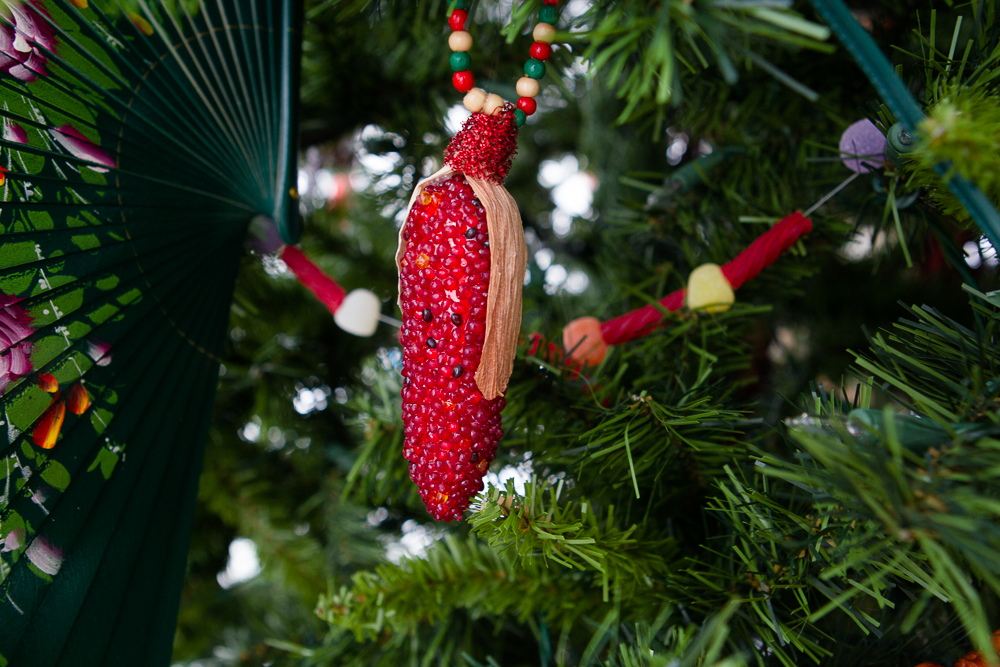 . A beaded ear of red corn dangles from one of the Christmas trees at the Governor\'s mansion. Photo by Mark Broste